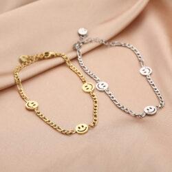 Smiley face armband goud en zilver