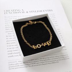 Love armband goud met steentjes