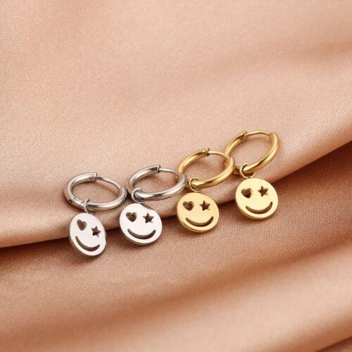 happy face oorbellen goud zilver